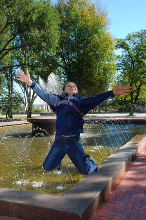 Jumping boy over fountain   photo