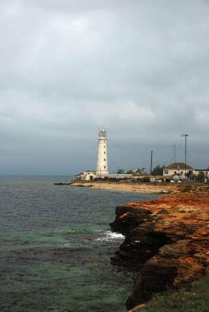 海の嵐上の灯台 写真素材