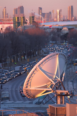 airwaves: Parabolic satellite dish space technology receivers over the city, Toronto, Canada