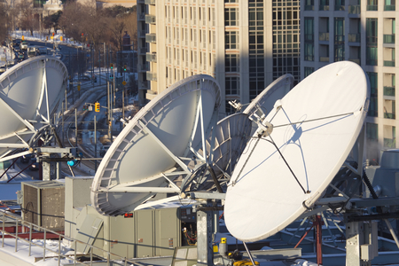satellite: Parabolic satellite dish space technology receivers over the city, Toronto, Canada