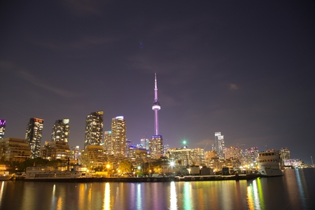 building cn tower: Toronto Skyline at night with a reflection in Lake Ontario