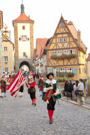 musketeer: ROTHENBURG OB DER TAUBER, GERMANY - September 5: Performers of the annual medieval Imperial City Festival, dressed in historical costumes on September 5, 2014 in Rothenburg ob der Tauber, Germany Editorial