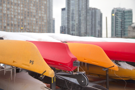 stored: Colorful Kayaks stored for winter