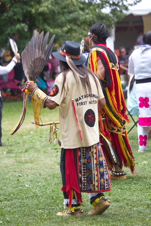 Fort York, Toronto - July 25, 2015 - Native American performers dancing at a pow-wow dressed in their traditional costumes representing their tribes. Stock Photo