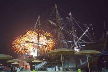 Toronto waterfront, Ontario, Canada - July 1st: People are watching Canada Day fireworks over Spanish 18th century Galleon Andalucia replica berthed at the Toronto city Waterfront on July 1st 2016.