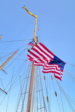 Tall ship Pride of Baltimore II mast with US flag on it, Toronto harborfront, Canada Stock Photo