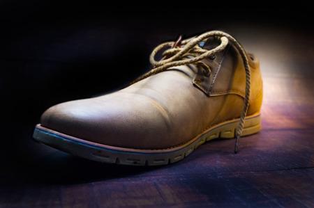 Suede shoe close up on vintage wooden background Reklamní fotografie
