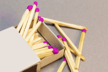Wooden matches in a box scattered close-up Stock Photo