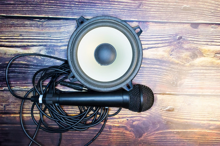 Microphone and speaker on cable with wooden table
