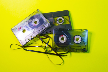 Three cassettes with tangled tape.