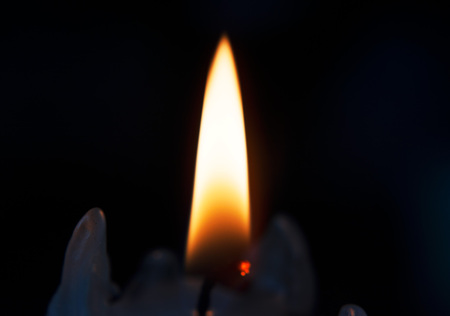 Just a burning candle in the dark. Banco de Imagens
