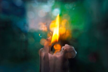 Abstract blurred background with a candle in the center