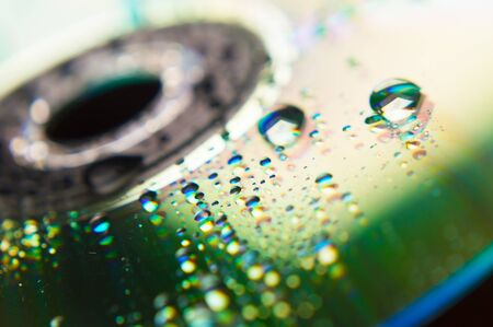 Compact disc in the background and close-up raindrops Stock Photo