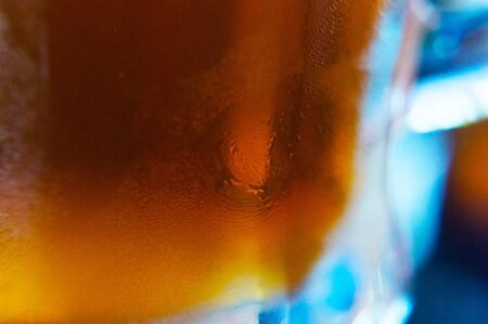 Background of beer and misted glass color close-up Imagens
