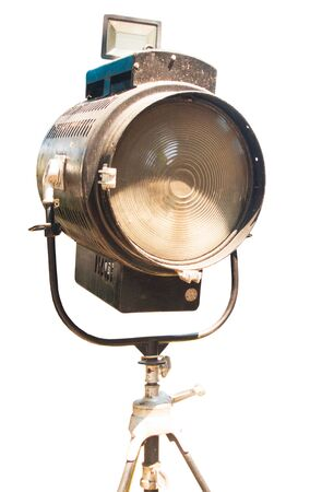 An old lighting lantern for filmmaking is isolated from the background.