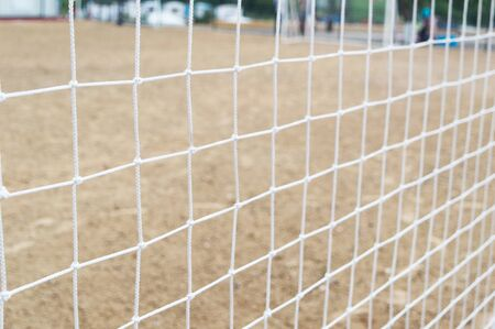 Football net close-up on the beach
