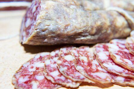 Sliced dry salami macro filming 写真素材