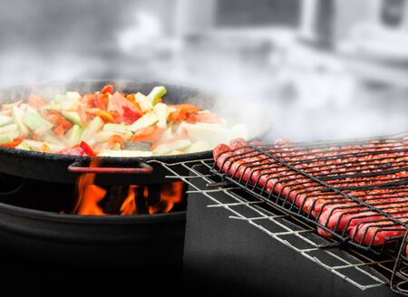 Grilled barbecue and vegetables on the fire 写真素材