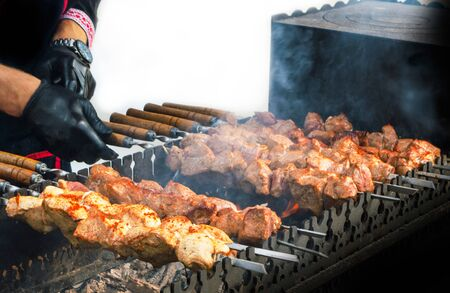 Cooking Barbecue on a gratar on a white background