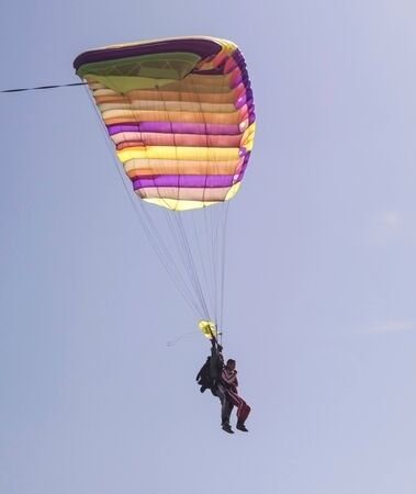 Training jump of two skydivers 写真素材