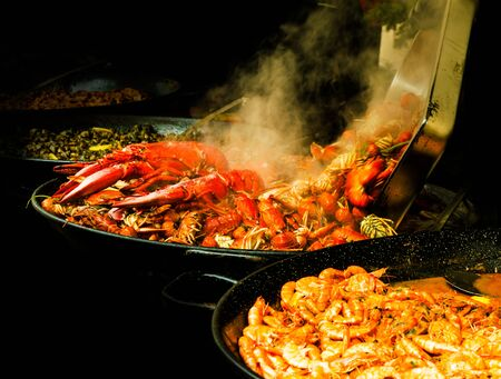 Cooking Seafood on a crust of crayfish and shrimp on a dark background