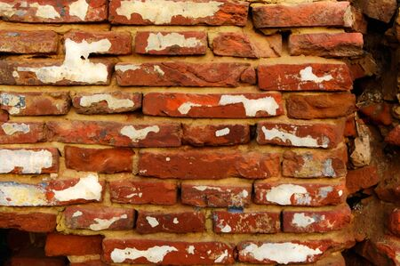 Background of an old brick red wall Stock fotó
