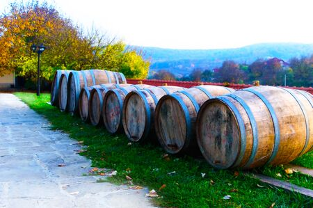Wooden wine barrels in the courtyard of the monastery in the fall
