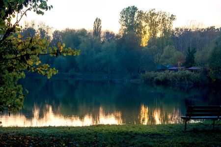 Sunset on the lake in late autumn in the park