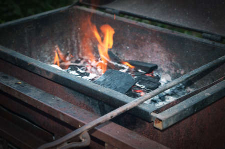 Barbecue with hot coals and fire