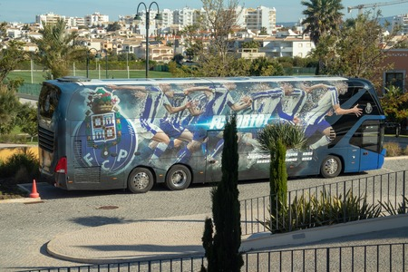 Lagos, Portugal - April, 13, 2019: coach parked outside the Cascada Wellness Resort where the squad was training. Tight security at the hotel. Редакционное
