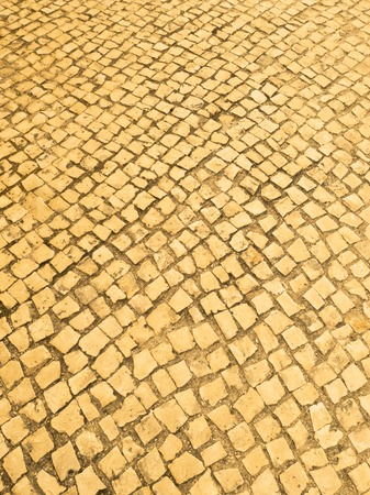 Textured yellowish paving tiles provide an interesting design feature.