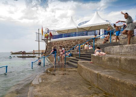 St Helier, Jersey, United Kingdom, - 07, 25, 2019: holidaymakers enjoying facilities at the sea Lido