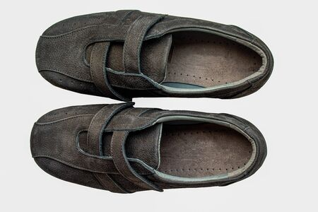 Top down view of a pair of casual shoe to fit swollen feet isolated on a white background