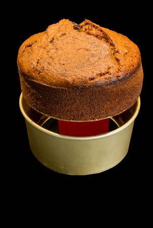 Using a can to remove freshly baked banana bread from its baking container