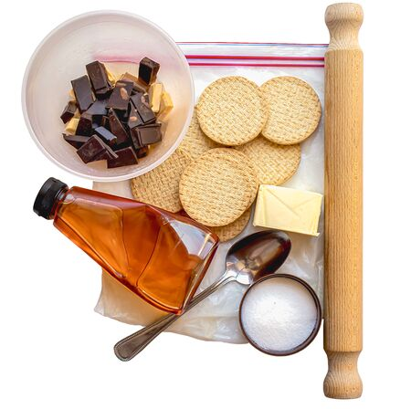 Top down view of the equipment and ingredients for making chocolate praline isolated on a white background