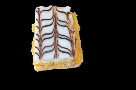 top-down view of a slice of mille feuille isolated on a black background 免版税图像