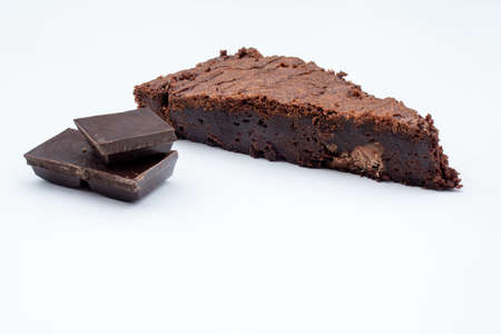 A slice of chocolate browne isolated on a white background 免版税图像