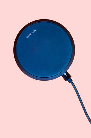 Overhead view of a simple circular fast charger isolated on a white background