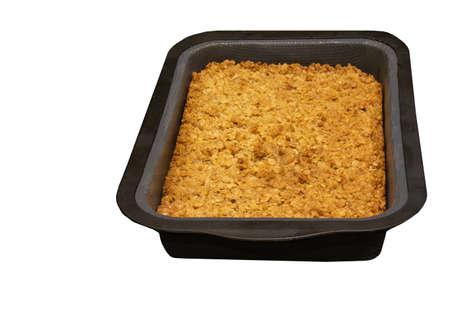 top-down view of home-made flapjack in a silicon container