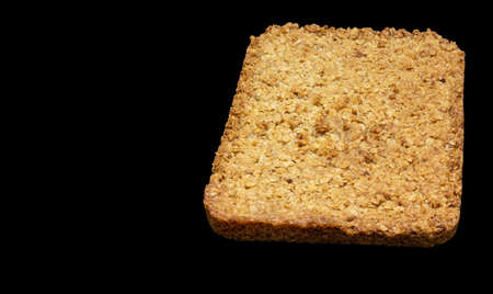 top-down view of home-made flapjack isolated on a black background 免版税图像