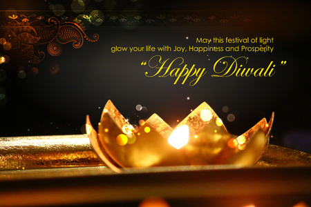dipawali: illustration of golden lotus shaped diya on abstract Diwali background Stock Photo