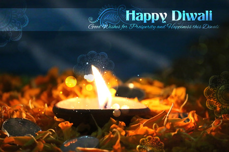 diwali greeting: illustration of decorated Diwali diya on flower rangoli