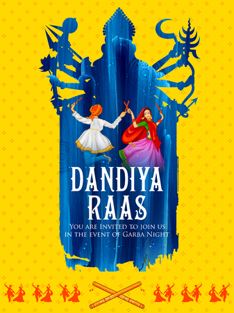 Coppia che gioca Dandiya in discoteca Garba Night per il festival Navratri Dussehra dell'India