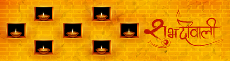 Burning diya on Diwali Holiday background for light festival of India with message in Hindi meaning Happy Dipawali