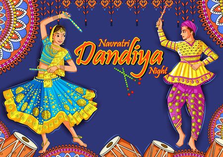 Indian couple playing Garba in Dandiya Night Navratri Dussehra festival of India