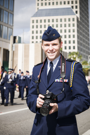 veteran's day: ORLANDO  FL  - November 9, 2013 - Soldier with the camera during the Veteran s Day Parade, Orlando Florida