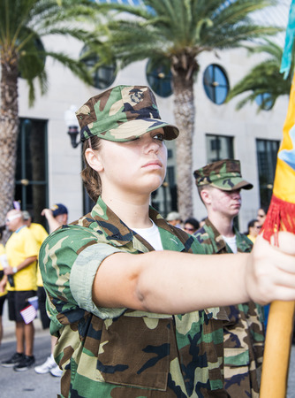veteran's day: ORLANDO  FL  - November 9, 2013 - Young girl in uniforme during the Veteran s Day Parade, Orlando Florida