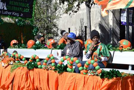 allegorical: ORLANDO FL- January 18, 2014 - African American boys and Allegorical wagon at Martin Luther King Parade in Orlando Florida