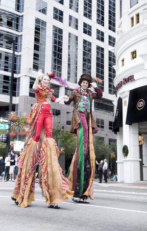 florida citrus: ORLANDO FL - December 30, 2013 -  People in costume on stilts at Florida Citrus Parade in Orlando Florida