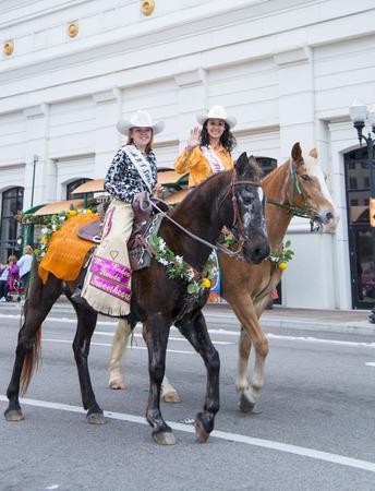 florida citrus: ORLANDO FL - December 30, 2013 -  Miss Rodeo in horseback at Florida Citrus Parade in Orlando Florida Editorial